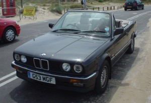 The 89 BMW pictured at Sandbanks, UK  - our mode of holiday transport is not such fun these days!
